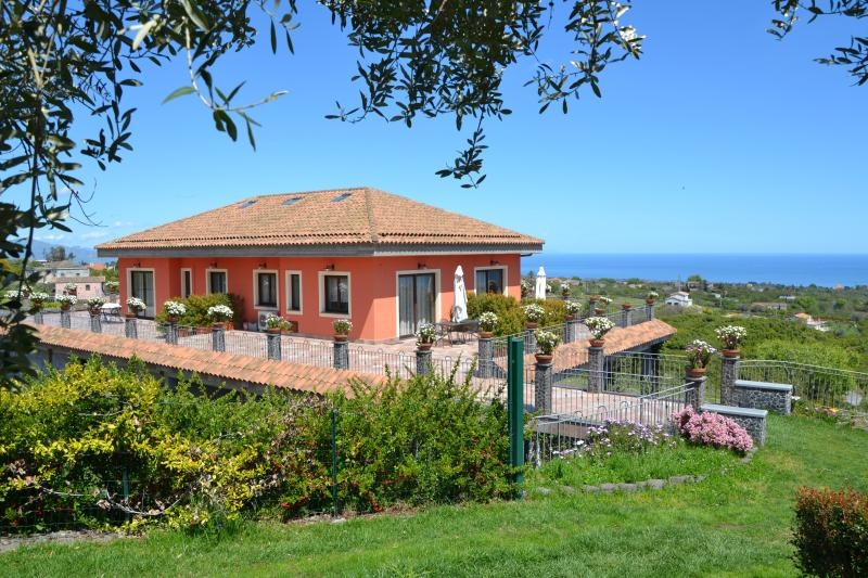 The villa is divided into 4 units with independent accesses and private terraces/garden.