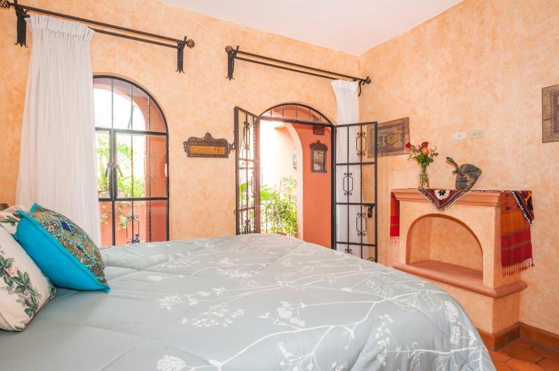 Floor to ceiling windows and doors onto terrace and passageway in Green Suite