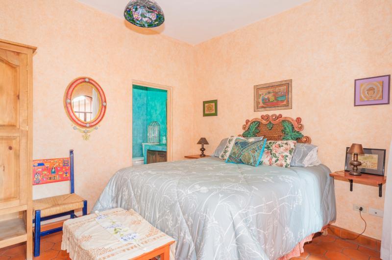 Green Suite bed, armoire, and door into bath