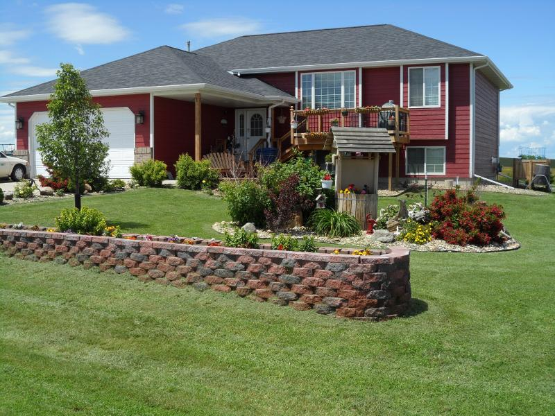 Beautiful landscaping, spacious 1/2 acre lot, front and back decks. Empty 2 car garage for use.