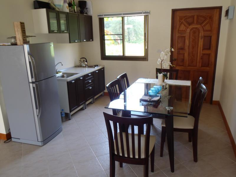 Large kitchen includes a stove and refridgerator