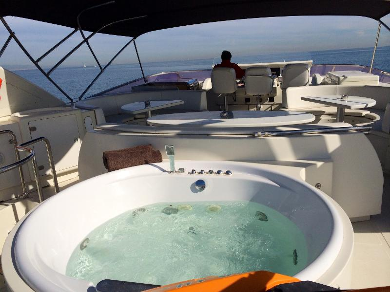 The flybridge is equipped with a powerful stereo, a BBQ Grill, Jacuzzi and sunbeds