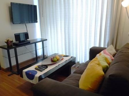 Comfortable living room with sofa and 32' TV