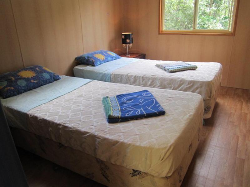 vierde slaapkamer met 2 eenpersoonsbedden