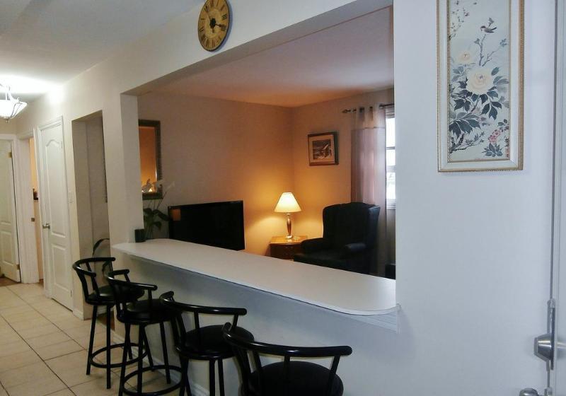 Suite 1. Open Concept Kitchen/Breakfast Bar overlooking Living Room.