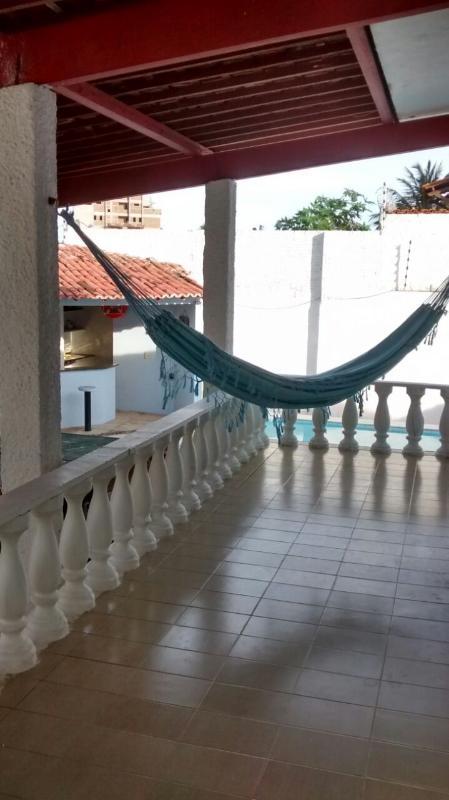 varanda lateral da casa, com redário