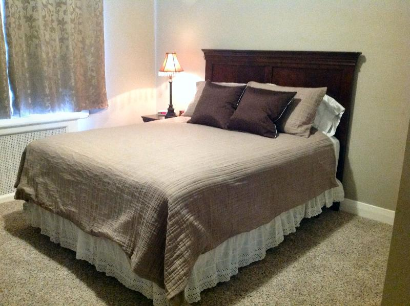 Inviting queen-size bed with luxurious  pillow-top mattress, fluffy pillows