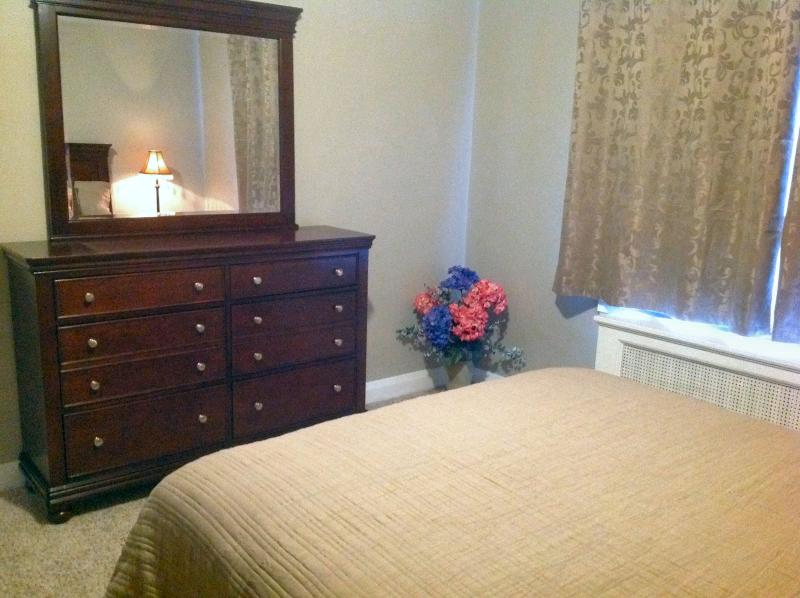 A mirrored dresser to use during your stay with us.