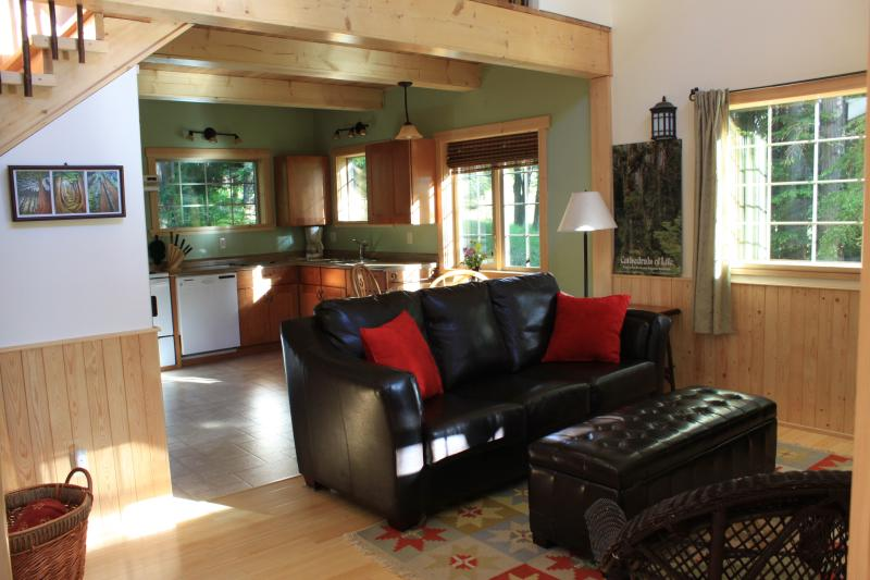 An open floor plan of the kitchen and living room is found in both cabins.