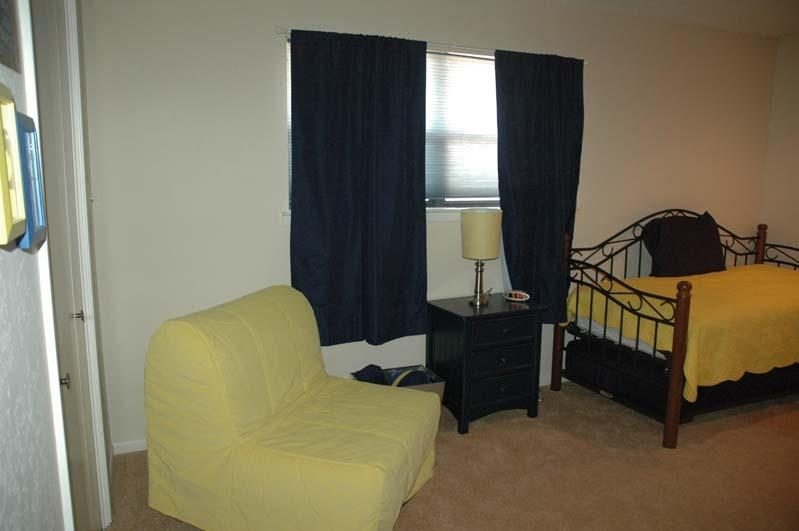 Large bunk room in cheerful navy and yellow