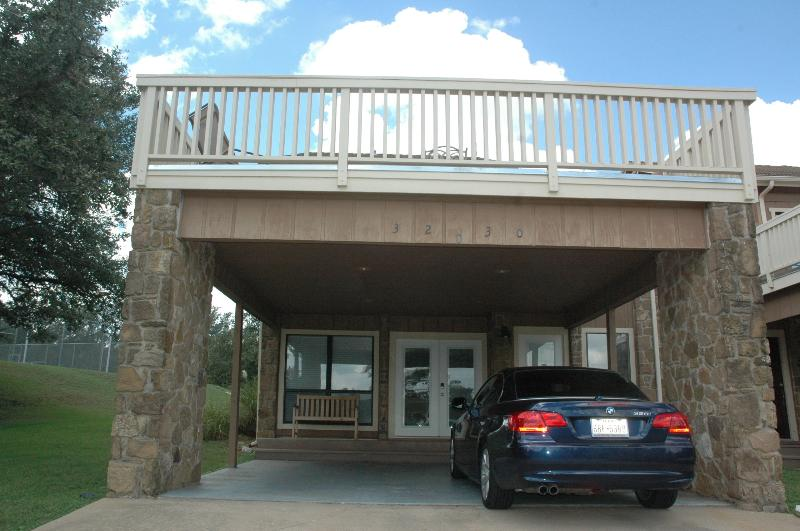Double car carport with upstairs balcony over