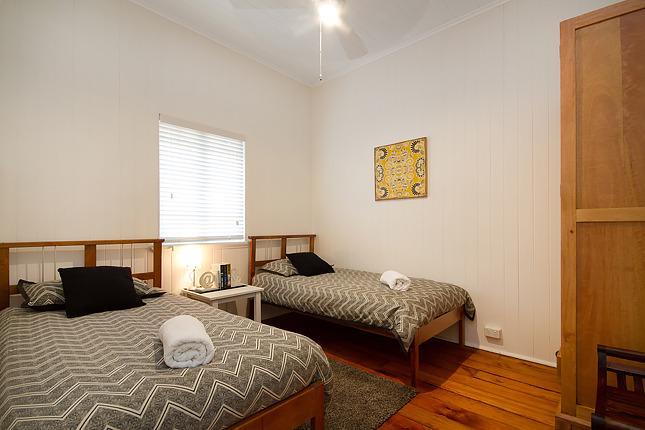 B3 2 x Single beds + fan & wardrobe