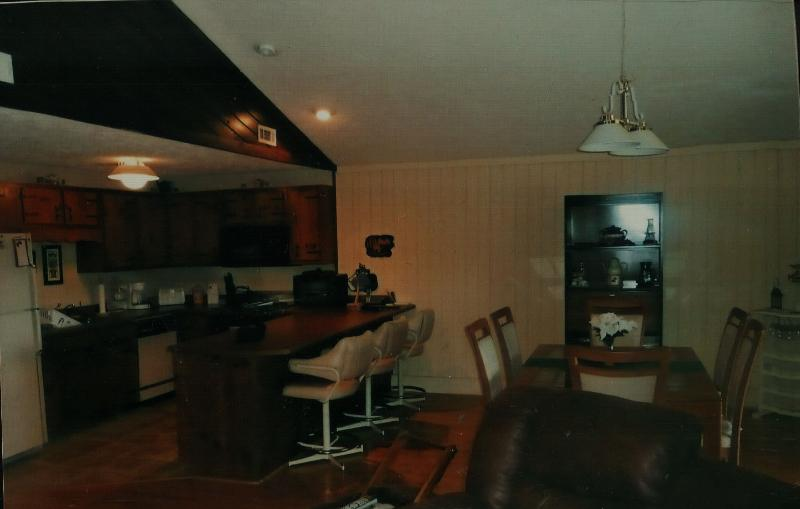 Open room kitchen with Jenn-Air stove and dining room combination.