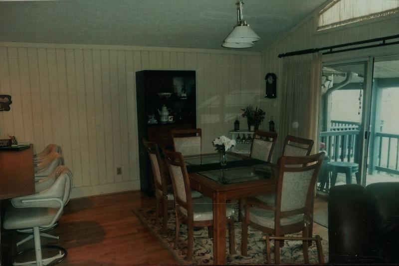 Dining room with hardwood floors and glass slider to the deck.