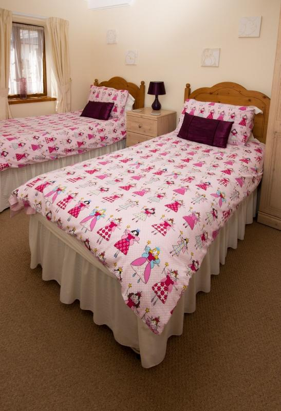 Twin room made up with children's bedding
