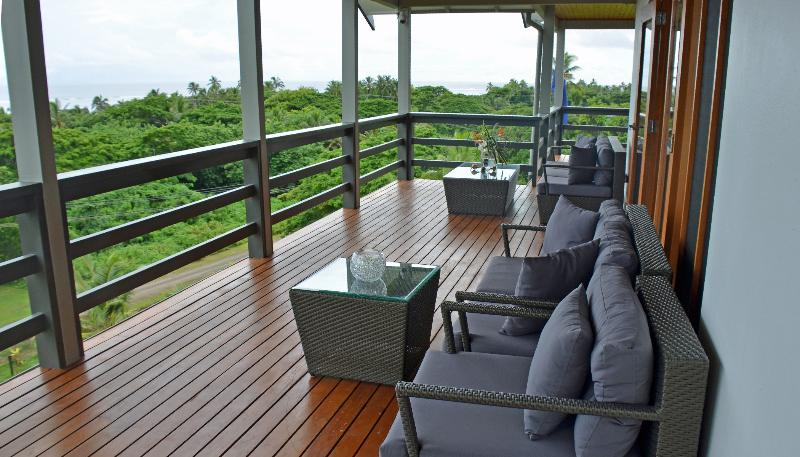 Large balcony/deck with amazing 180 degree views of  coral coast, reef & Pacific Ocean.