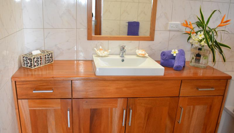Beautifully appointed & fully tiled, ensuites with mahogany finished vanities.