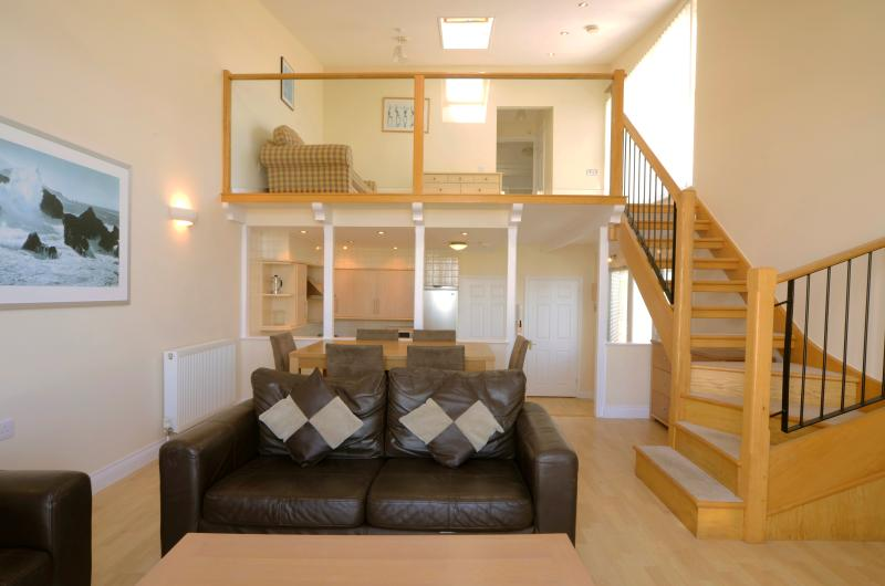 Waterfront luxury accommodation - double height lounge / dining area