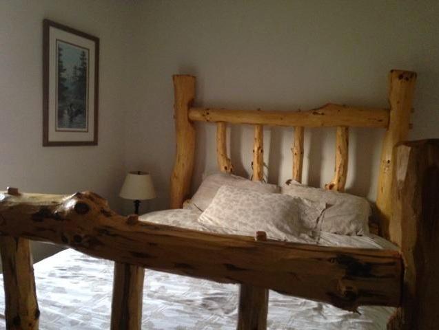 1st floor queen log bed with luxury linens