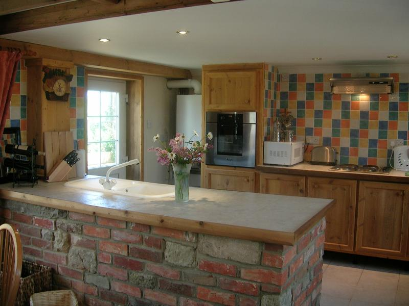 Open plan kitchen/dinner with bespoke units