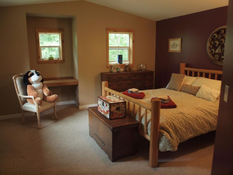 Queen size bed and private bathroom.