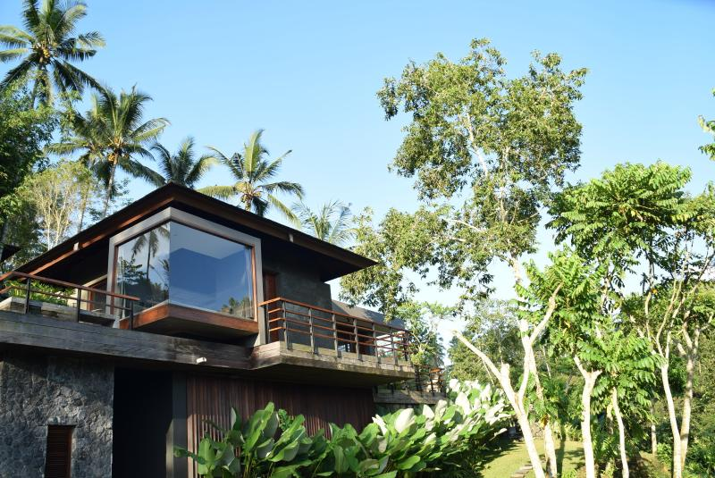 Villa Ylang and it`s unique design with a day bed inside glass cubicle overviewing the river bank