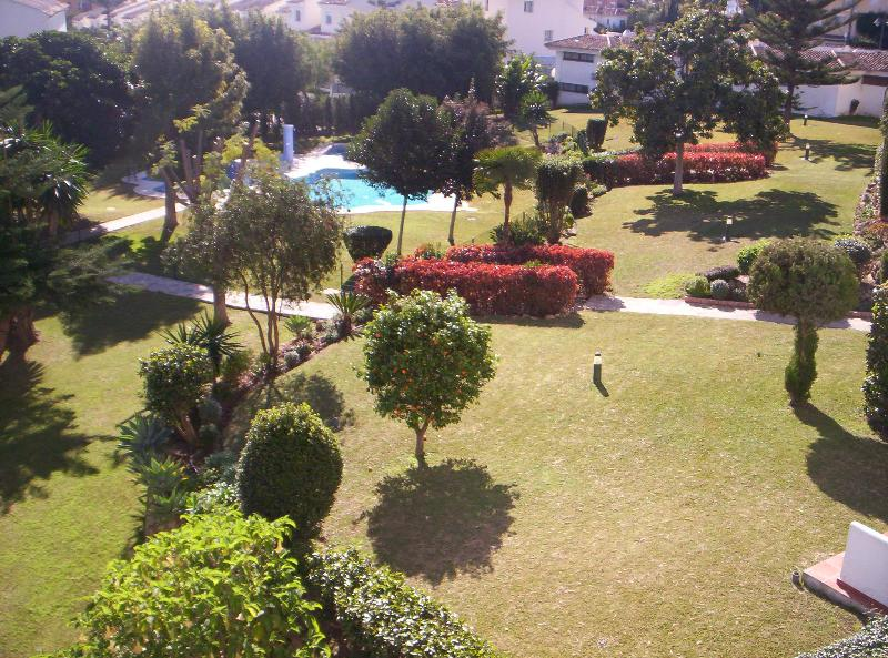 View from balcony overlooking gardens and pool