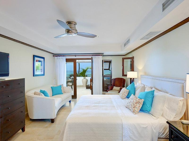 Master Bedroom, with doors leading onto the veranda, Flat Screen Cable TV and air conditioned