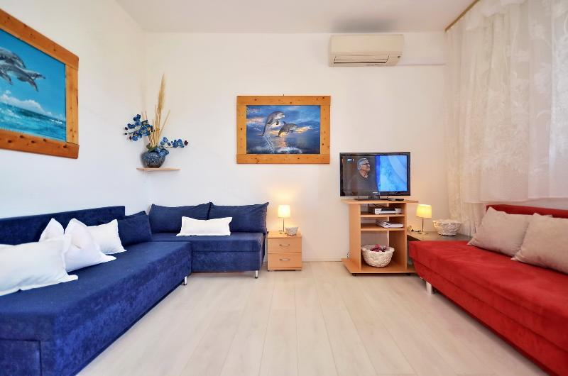 floor living room with two sofa bed, entrance to the terace with sea view