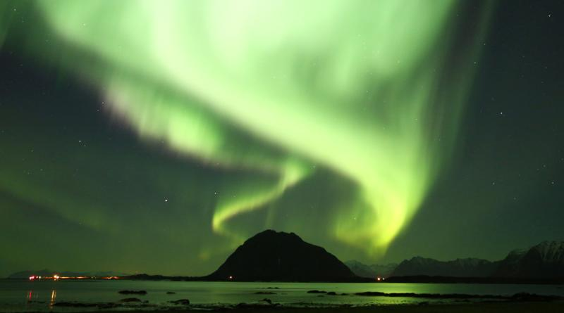 View from the kitchen window in winter: Northern lights.