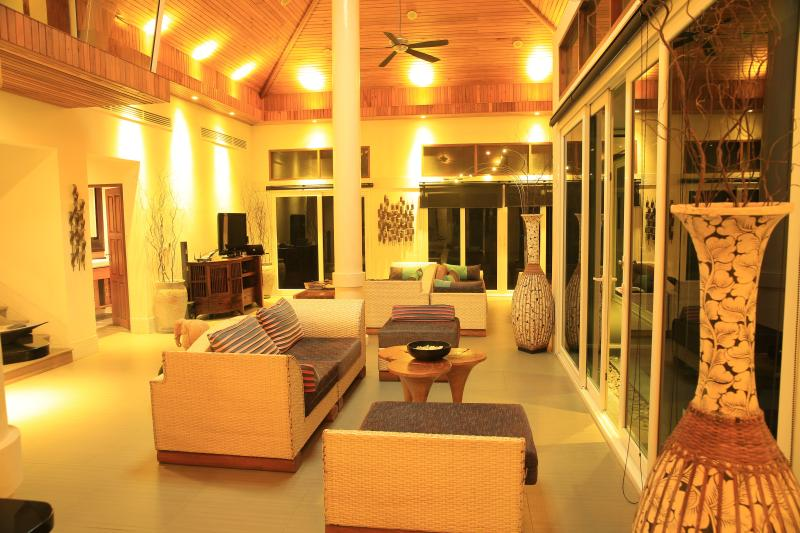 The large living area with Vaulted ceiling, and ceiling Fans which keep the room cool...