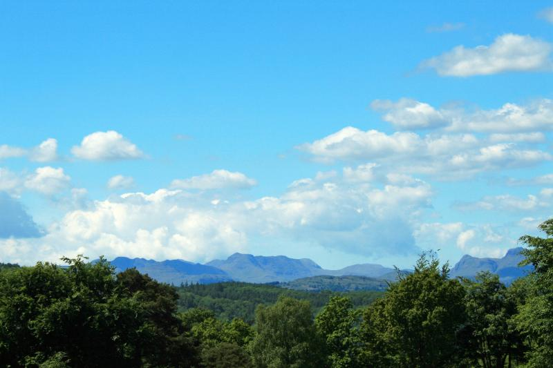 Distant view of mountains from the street outside the cottage