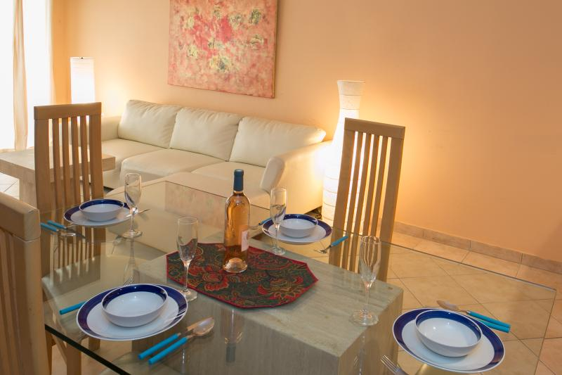 Spacious dining area to enjoy dinner at home.