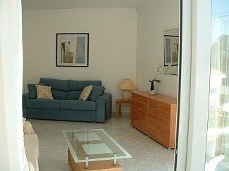 LARGE AIR CONDITIONED MODERN LIVING ROOM WITH DOUBLE SOFA BED