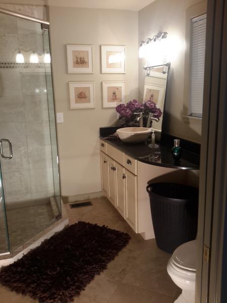 granite counter tops,  heated Travertine floor.glass enclosed  travertine shower