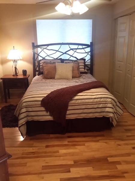Master bedroom queen bed on main floor