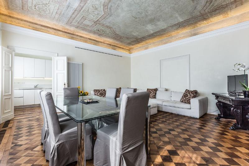 antique partuet flooring and original frescoed ceiling confer a unique charm to the ambience