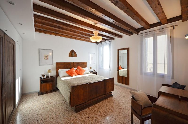 cozy and spacious double bedroom with beamed ceiling