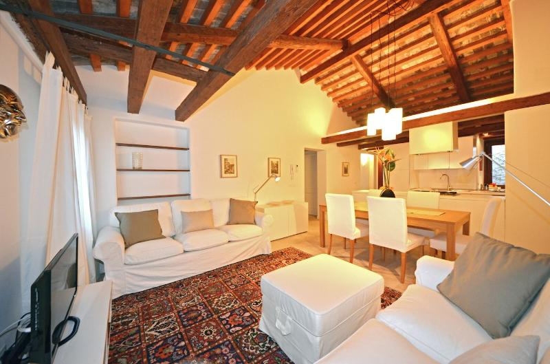 living room of the top floor apartment with wooden beams