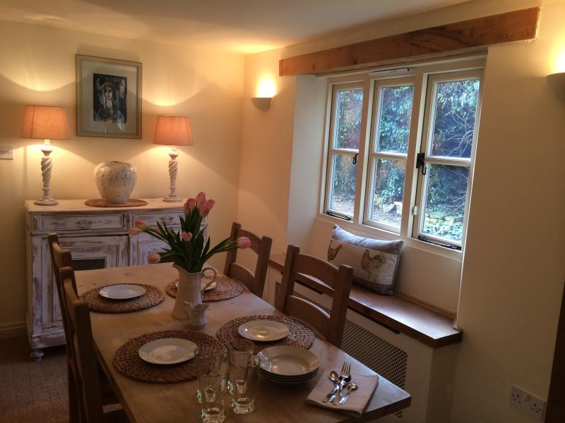 Dining area with seating for 4/ 6 people .Very light during the day and extremely cosy at nigh time.