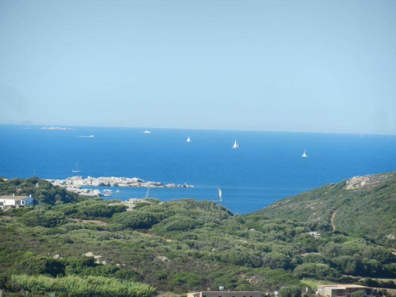Panorama to Marmorata beach and Corsica