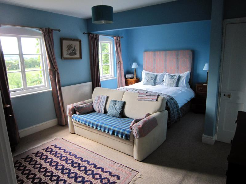 Bedroom One with views to the south & bathroom en suite. Includes a sofa-bed suitable for children