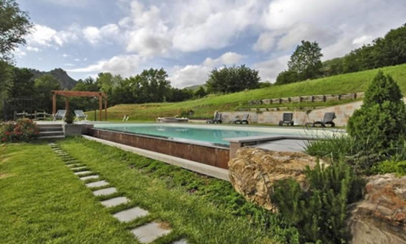 Relax by the large pool, in extensive grounds