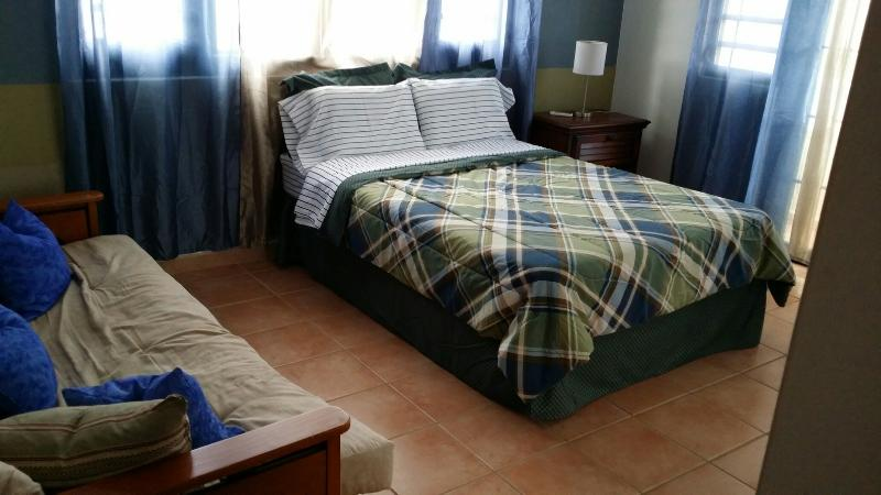 2nd bedroom with ocean view balcony, full bed and full sofa bed.