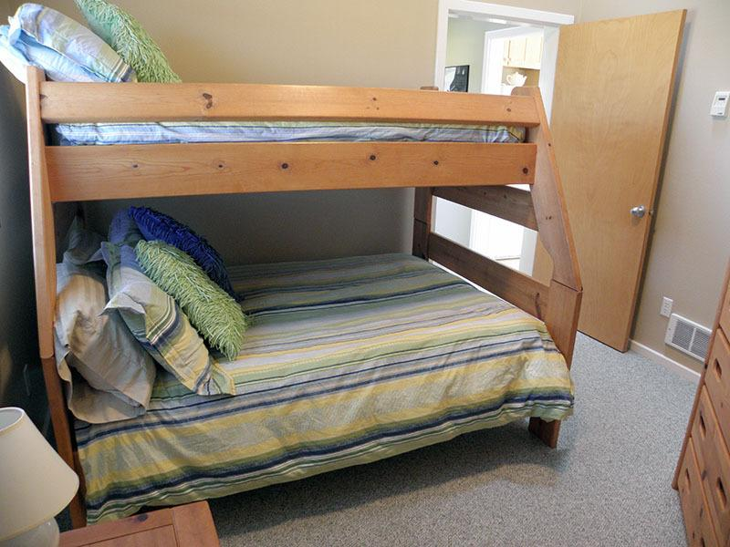 The 3rd bedroom has a bunk bed with a double on the bottom and a twin on top.