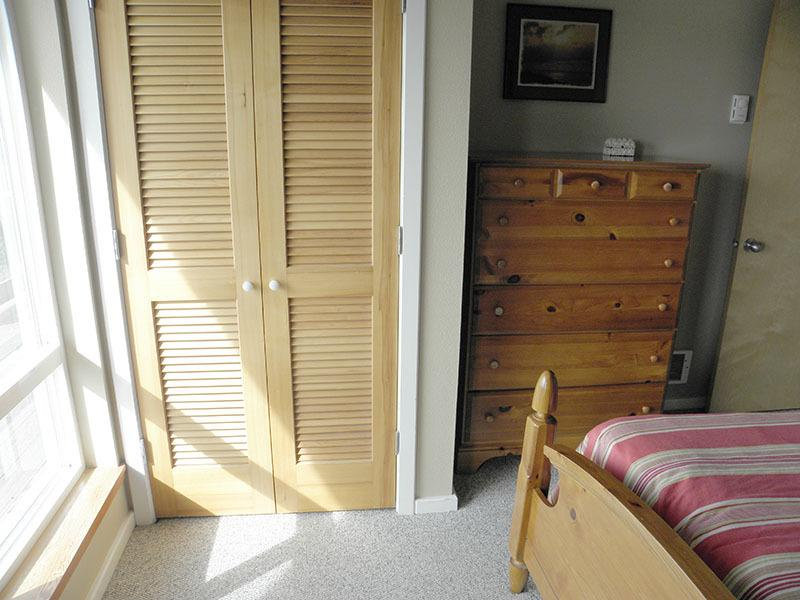 There is a double bed in the second bedroom and a private door to the west deck.