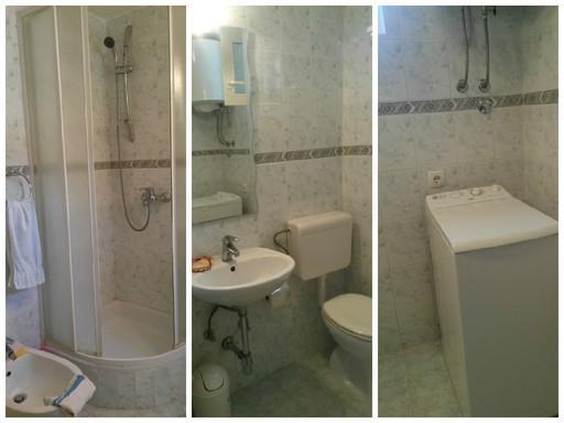 Bathroom with shower, bidet and washing maschine on the ground floor