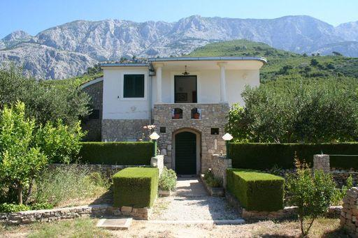 House front - house offers a great view of the mountain above the town, while located near the beach