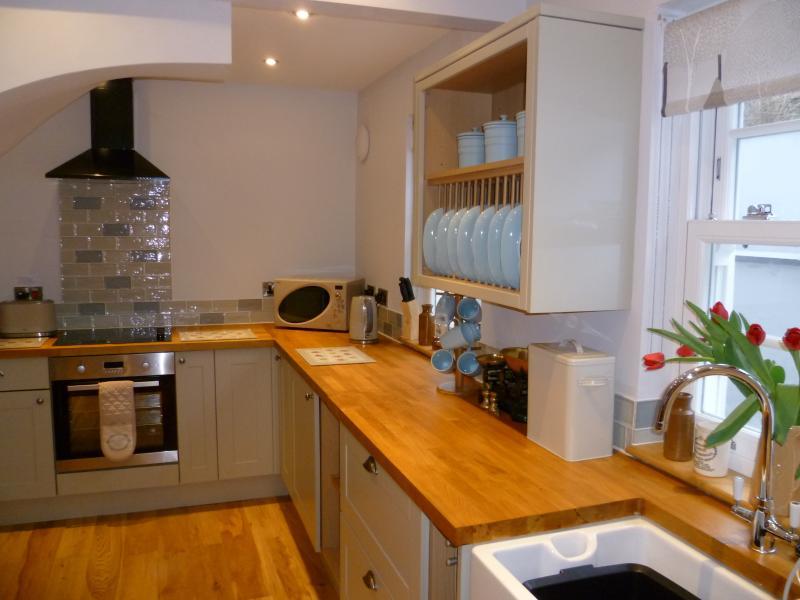 Belfast sink, kitchen oak worktops and wood block flooring