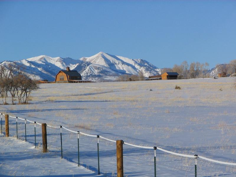 winter on ranch view of the barn etc
